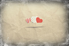 Hearts on crumpled paper Royalty Free Stock Image