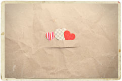 Hearts on crumpled paper Stock Photo