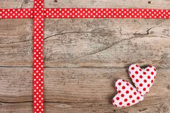 Hearts decoration on wooden background. Dotted hearts decoration on wooden background royalty free stock image