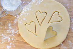 Hearts of dough. Sprinkled with flour Stock Photo