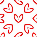 Hearts drawn by hand with rough brush. Romantic seamless pattern. Stock Images