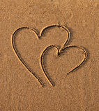 Hearts drawn on sand Stock Images