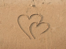Hearts drawn on sand Stock Photo