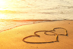 Hearts drawn on the sand. Of a beach Royalty Free Stock Image