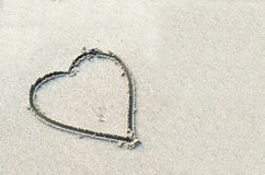 Hearts drawn on the sand. Of a beach Stock Photography