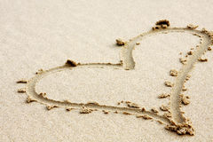 Hearts Drawn In The Sand With Seafoam And Wave Royalty Free Stock Images