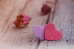 Hearts and dried roses n wooden background Royalty Free Stock Photos