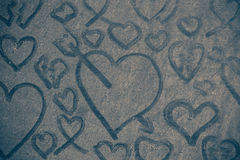 Hearts on dusty floor. Arrows with hearts on dusty floor Stock Images