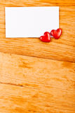 Hearts and empty note Stock Photography