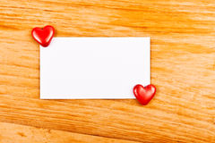 Hearts and empty note Royalty Free Stock Photo
