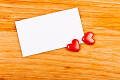 Hearts and empty note Royalty Free Stock Photography
