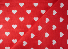 Hearts on fabric Stock Photos