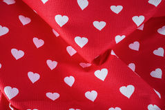 Hearts on fabric Stock Images