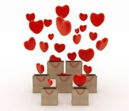 Hearts falling into gift bags Stock Photography