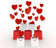Hearts falling into gift bags Royalty Free Stock Photo