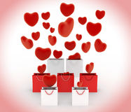 Hearts falling into gift bags Royalty Free Stock Photos
