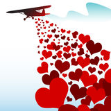 Hearts falling from a plane Royalty Free Stock Image