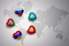 Hearts with flags of the five countries of the eurasian economic union, russia, belarus,armenia,kazakhstan, kyrgyzstan on a world. Map background. concept Stock Photo