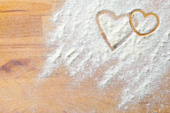Hearts of flour on wooden table Royalty Free Stock Image