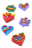 Hearts and flowers. Some plasticine hearts and flowers on a white background Stock Images