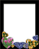Hearts and flowers. Black frame with several hearts and flowers Royalty Free Stock Image