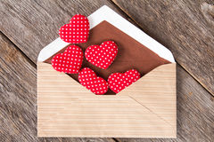 Hearts fly out from the envelope. Royalty Free Stock Images
