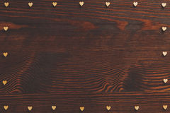 Hearts frame on wood table Royalty Free Stock Photography
