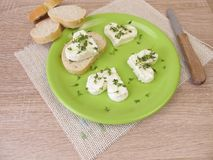 Hearts from fresh cheese with cress sprouts. Hearts from fresh cheese with green cress sprouts Royalty Free Stock Photo