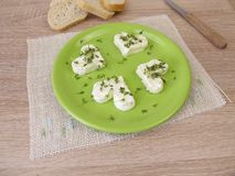 Hearts from fresh cheese with cress sprouts. Hearts from fresh cheese with green cress sprouts Royalty Free Stock Images