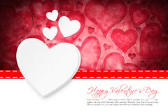 Hearts in front of a hearts background with `Happy Valentine`s Day` message Stock Image