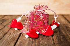 Hearts and gift box on wooden background Royalty Free Stock Image