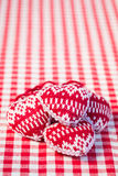 Hearts on gingham tablecloth Stock Images