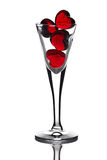Hearts in glass. Glass hearts in bowl on white background Royalty Free Stock Photo