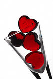 Hearts in glass. Glass hearts in bowl on white background Royalty Free Stock Photography