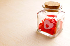 Hearts in a glass jar on wooden surface - Series 2 Stock Images
