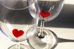 Hearts in glasses for Valentine`s Day. Paper love hearts in champagne glasses for Valentine`s Day Valentines Background, Wedding Love Concept circle round in a stock photo
