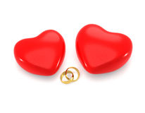 Hearts and gold rings. Royalty Free Stock Photos