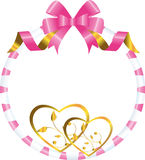 Hearts of gold in a round frame with a bow Royalty Free Stock Images