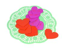 Hearts on a green paper lace doily Stock Images
