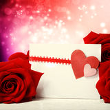 Hearts greeting card with red roses Stock Images