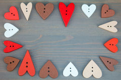 Hearts on grey wooden background. Stock Image