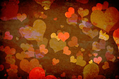 Hearts on grunge wall Stock Images