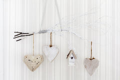 Hearts hanging on a bunch of branches Royalty Free Stock Image