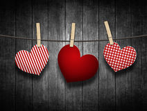 Hearts hanging on clothesline over wooden background Stock Image