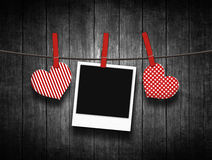 Hearts hanging on clothesline over wooden background Royalty Free Stock Photos