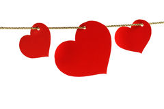 Hearts hanging from a golden twine Stock Image