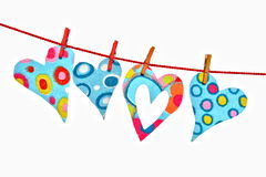 Hearts hanging on line Stock Image