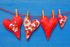 Hearts hanging on line Stock Images