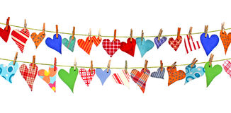 Hearts hanging on lines Royalty Free Stock Photos