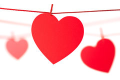 Hearts hanging on rope. Isolated on white Royalty Free Stock Photo